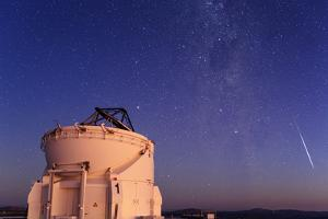 A Bright Meteor, the Southern Cross, and the Milky Way at Dusk over the Cerro Paranal Observatory by Babak Tafreshi