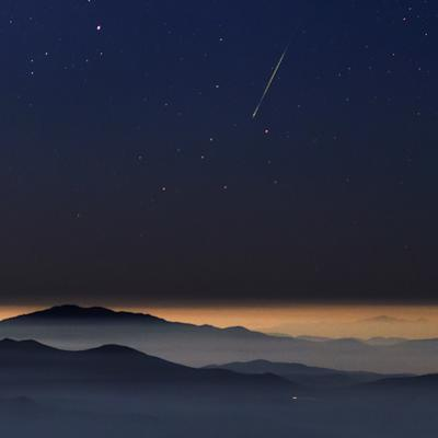 A Colorful Meteor Photographed Above the Inversion Layer by Babak Tafreshi