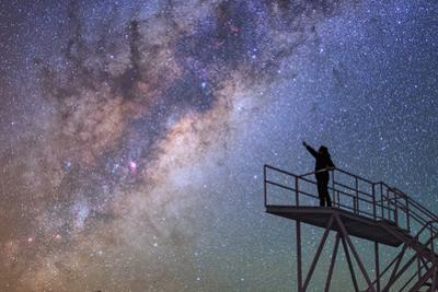 A Stargazer Points at the Constellations Scorpius and Sagittarius at the Cerro Paranal Observatory