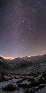 A Starry Sky over the Zagros Mountains after a Snowstorm. the Setting Moon Shines on the Peaks by Babak Tafreshi