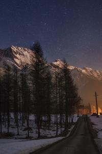 A Starry Winter Night in the Austrian Alps, with Bright Star Deneb, in the Constellation Cygnus by Babak Tafreshi