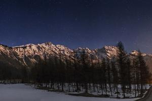 A Starry Winter Night in the Austrian Alps with Constellation Cygnus, the Swan, on the Right by Babak Tafreshi