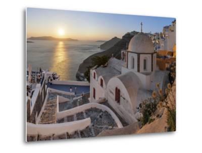 A Summer Sunset on the Mediterranean Island of Santorini, with a Historic Church