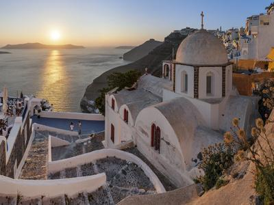 A Summer Sunset on the Mediterranean Island of Santorini, with a Historic Church