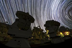 A Time-Exposure Image of Star Trails over the Alma Radio Telescopes, 5000 Meters High in the Andes by Babak Tafreshi