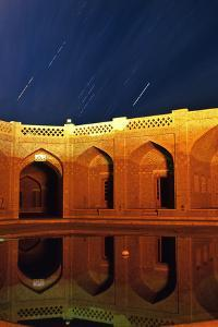 A Time-Exposure of Constellation Orion Rising over a Caravansary by Babak Tafreshi
