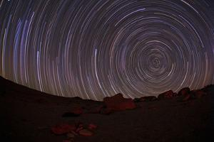 A Time-Exposure of Star Trails around the South Celestial Pole Due to the Earth's Rotation by Babak Tafreshi