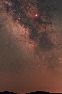 A Totally Eclipsed Moon, Positioned in the Sky Toward the Center of the Milky Way Galaxy by Babak Tafreshi