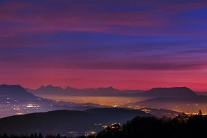 Alps at Dusk with Light of Towns Near the Border of Switzerland and France by Babak Tafreshi