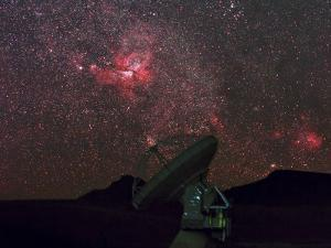 An Alma Telescope Photographed with a Special Deep Sky Filter to Reveal the Nebulosity in the Sky by Babak Tafreshi