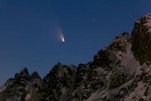 Comet Panstarrs, C/2011 L4, Streaking over Ocean-Side Mountains at Twilight by Babak Tafreshi