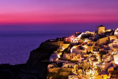Dusk over the Aegean Sea and a White-Washed, Cliff-Top Town on Santorini Island by Babak Tafreshi
