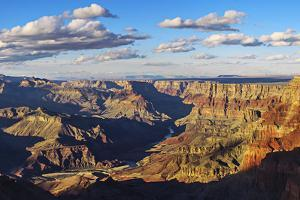 Golden Sunlight at Sunset on the Different Layers of Exposed Rockin the Grand Canyon by Babak Tafreshi