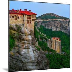 Historic Monasteries Overlook a Valley from Sandstone Pillars by Babak Tafreshi