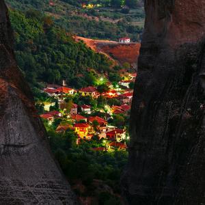 Houses of the Town Kalabaka are Seen Through Giant Sandstone Pillars by Babak Tafreshi
