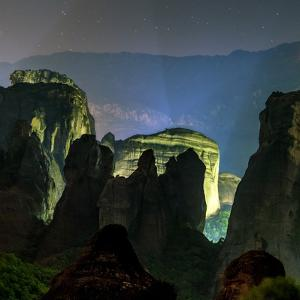Light Illuminates the Sandstone Pillars of the World Heritage Site of Meteora by Babak Tafreshi