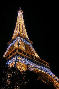 Low Angle View of the Eiffel Tower Lit Up at Night by Babak Tafreshi