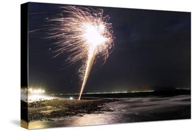 New Year Fireworks on the Atlantic Coast. Neighboring Lanzarote Island Shines in the Distance
