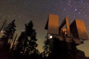 Night Sky over the Large Binocular Telescope on Mount Graham by Babak Tafreshi