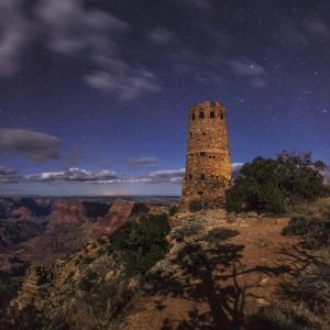 Night Sky with Moving Clouds Above the Grand Canyon and the South Rim Watchtower by Babak Tafreshi