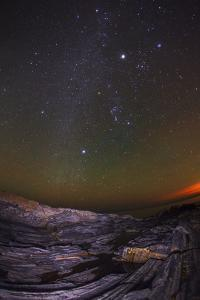 Night Sky with the Milky Way, Canis Major, Orion, Taurus, Jupiter, Sirius, Airglow, and City Lights by Babak Tafreshi