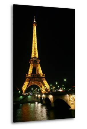 Night View of the Eiffel Tower and a Nearby Bridge
