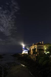 Night View of the Historic Santa Marta Lighthouse and Museum, on the Atlantic Coast by Babak Tafreshi