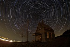 Star Trails Above an Old Wooden Church Overlooking Innsbruck, Austria by Babak Tafreshi