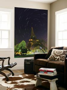 Star Trails around the North Celestial Pole, Marked by Star Polaris, over the Eiffel Tower by Babak Tafreshi
