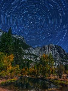 Star Trails Circling around the North Celestial Pole, Polaris, on a Moonlit Night by Babak Tafreshi