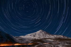 Star Trails Circling Polaris Above Mount Damavand, a Live Volcano, in Iran by Babak Tafreshi