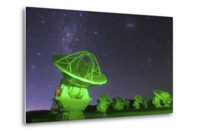 Starry Sky with the Magellanic Clouds over the Alma Radio Telescopes, 5000 Meters High in Andes by Babak Tafreshi