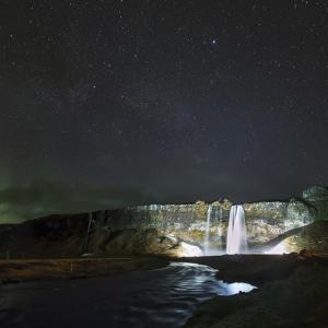 Stars Above Seljalandsfoss, a Waterfall in Southern Iceland by Babak Tafreshi
