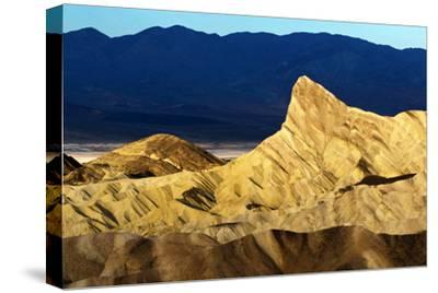 Sunlight on Eroded Landscape at Zabriskie Point. the Iconic Manly Beacon Formation Is Near Center