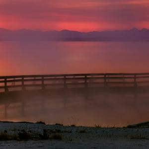 Sunrise Begins at the Steaming West Thumb Geyser Basin, on Yellowstone Lake by Babak Tafreshi