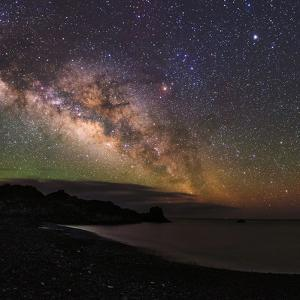 The Arc of the Milky Way Rises Above the Shores of the Atlantic Ocean by Babak Tafreshi