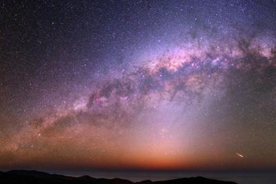 The Bulge of the Milky Way, Blue Zodiacal Light, and a Satellite Flare over the Atacama and Pacific by Babak Tafreshi