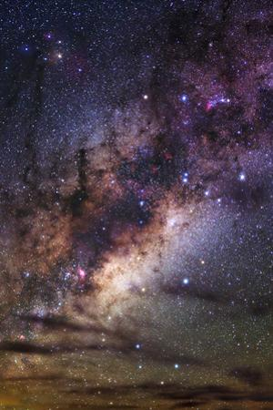 The Milky Way and Passing Clouds Appear in the Dark Night Sky of La Silla Observatory