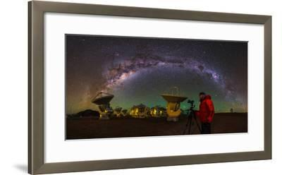 The Milky Way Appears over a Photographer and the Alma Radio Telescopes