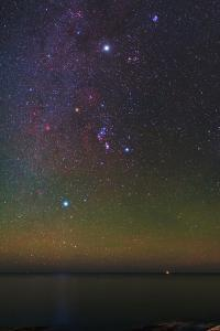 The Milky Way, Constellations, Sirius, and Bright Jupiter with Green and Red Airglow by Babak Tafreshi