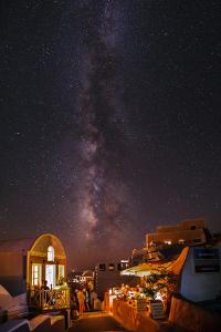 The Milky Way from Scorpius and Sagittarius, to Cygnus at Top, over Candle-Lit Restaurants by Babak Tafreshi
