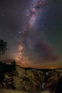 The Milky Way over Lower Yellowstone Falls and the Yellowstone River by Babak Tafreshi