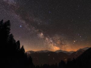 The Milky Way over Snow-Covered Austrian Alps in Tyrol, Austria by Babak Tafreshi