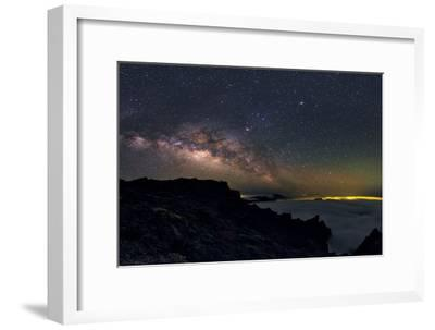 The Milky Way Rising Above La Palma Island. Clouds Fill Volcanic Crater, Caldera De La Taburiente