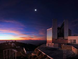 The Moon and Jupiter Shine in the Evening Twilight over the New Technology Telescope by Babak Tafreshi