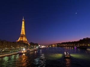 The Moon Meets with Planets Venus and Jupiter over the Eiffel Tower and the Seine River by Babak Tafreshi
