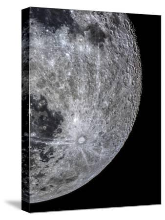 The Moon Through a Telescope with Features in the Southern Highland Region, Covered with Craters