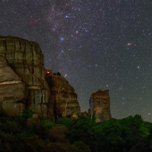 The Night Sky Above a Monastery Built into Sandstone Cliffs by Babak Tafreshi