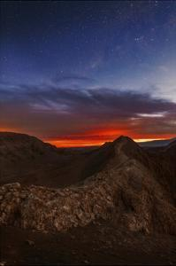 The Night Sky in the Evening Twilight at the Valley of the Moon by Babak Tafreshi