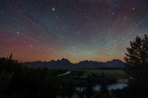 The Night Sky over the Grand Teton National Park and the Snake River by Babak Tafreshi